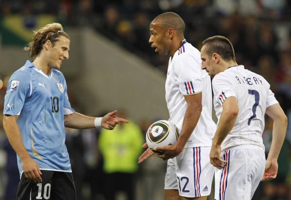 Pardon their French? Think not...Forlan contends with Henry, Ribery